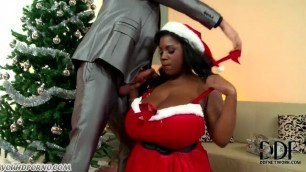 Busty black woman fucks a man during Christmas